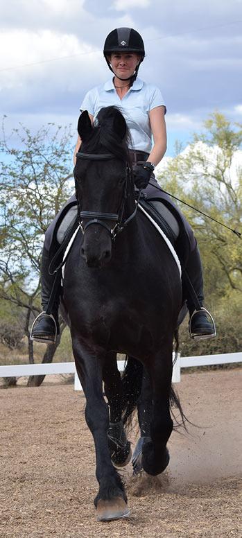 Emily riding black horse